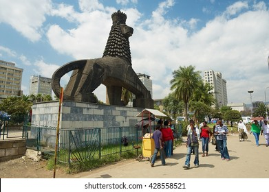 ADDIS ABABA, ETHIOPIA - JANUARY 18, 2010: Unidentified people walk by the street next to the iconic statue of the Lion of Judah in Addis Ababa, Ethiopia.