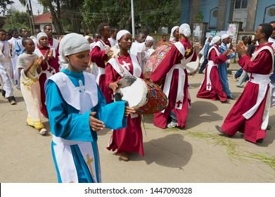 Addis Ababa, Ethiopia - January 19, 2010: Ethiopian people wearing traditional dresses take part in procession celebrating Timkat religious Orthodox festival at the street in Addis Ababa, Ethiopia.