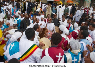 Addis Ababa, Ethiopia - January 19, 2010: Crowd of happy Ethiopian people celebrating Timkat religious Orthodox festival playing music and dancing at the street in Addis Ababa, Ethiopia.