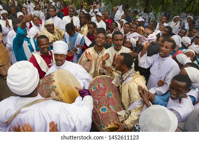 Addis Ababa, Ethiopia - January 19, 2010: Crowd of pappy Ethiopian people celebrating Timkat religious Orthodox festival playing music and dancing at the street in Addis Ababa, Ethiopia.