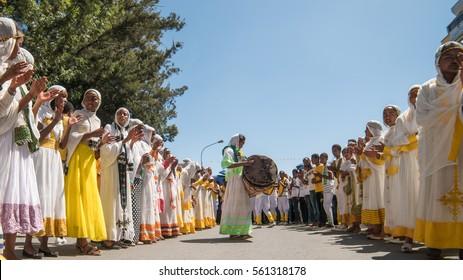 Addis Ababa - Jan 19: Clergy accompany the singing and chanting of Ethiopian Orthodox followers with kebero, traditional drum, during Timket celebrations on January 19, 2017 in Addis Ababa, Ethiopia.