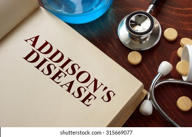 Addisons disease  written on book with tablets. Medicine concept.