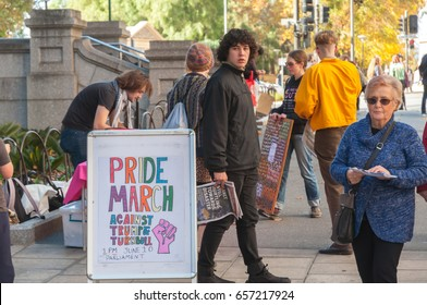 Adelaide, AU - June 10, 2017: South Australians gather at Parliament House to protest Trump's assumed support for laws discriminating against LGBTI people in the name of religious freedom.