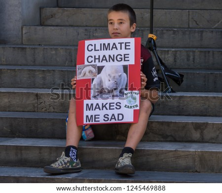 Adelaide, AU - November 30, 2018: Hundreds of students in Adelaide gather outside of Parliament House demanding action on climate change.