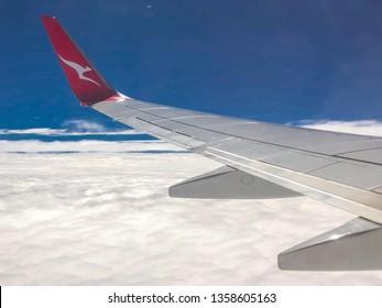 ADELAIDE, AUSTRALIA, 3 APRIL 2019; The Flying Kangaroo logo on a Qantas plane wing in the skies above Adelaide.