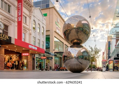 Adelaide, Australia - April 05, 2017: Rundle Mall and famous balls in Adelaide CBD at sunset. Rundle Mall attracts a lot of tourists severy year