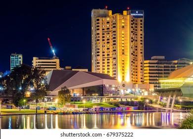 Adelaide, Australia - April 16, 2017: InterContinental Hotel in Adelaide CBD illuminated at night viewed across Torrens river