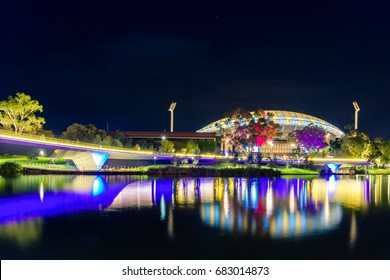 Adelaide, Australia - April 16, 2017: Adelaide Oval with footbridge across Torrens river illuminated at night time