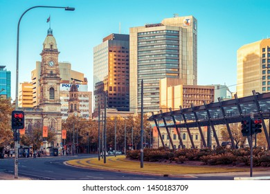 Adelaide, Australia - April 22, 2019: Colonial and modern buldings viewed across Victoria Square at sunset time