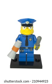 ADELAIDE, AUSTRALIA - August 11 2014:A studio shot of a Chief Wiggum Lego minifigure from the animated series The Simpsons. Lego is extremely popular worldwide with children and collectors.