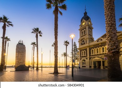 Adelaide, Australia - August 22, 2015: Moseley Square with Pioneer Memorial in the middle at night. Moseley Square is a public square in the City of Holdfast Bay at Glenelg.