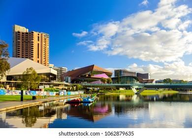 Adelaide,  Australia - August 27, 2017: Adelaide city skyline viewed across Torrens river in Elder Park on a bright day