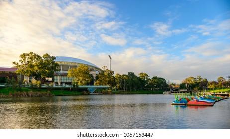 Adelaide, Australia - August 27, 2017: Adelaide Oval viewed across Torrens river in Elder Park at sunset