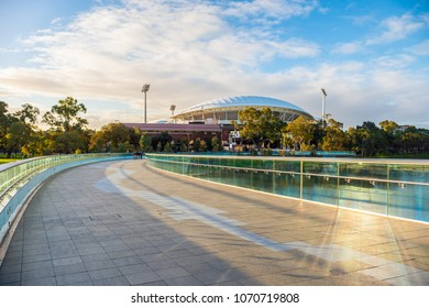 Adelaide, Australia - August 27, 2017: Iconic River Torrens Footbridge to Adelaide Oval viewed across Elder Park on bright day