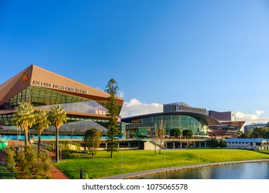 Adelaide,  Australia - August 27, 2017: Adelaide Convention Centre and Riverbank in city centre viewed across Torrens river at sunset