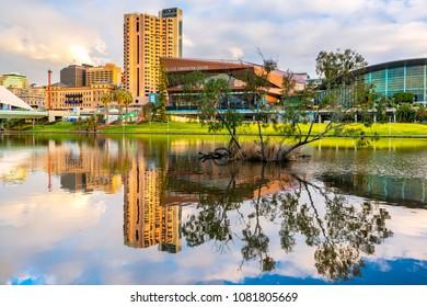 Adelaide,  Australia - August 27, 2017: Adelaide city skyline reflected in Torrens river in Elder Park at sunset