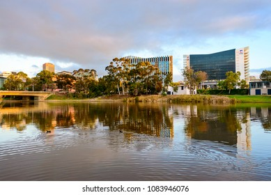 Adelaide,  Australia - August 27, 2017: University of Adelaide and UniSA buildings viewed across Torrens river at sunset