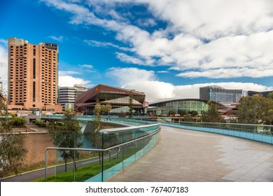 Adelaide, Australia - August 27, 2017: Adelaide city view across Torrens river footbridge from northern bank during winter time