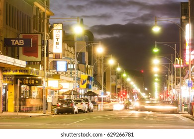 Adelaide, Australia - August 3, 2015: An evening sky looms over Hindley Street as a car pulls into a parking spot.