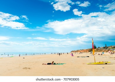 Adelaide, Australia - December 19, 2015: People relaxing and having fun at Moana Beach on a bright warm summer weekend. Moana is a great family beach for all ages