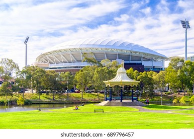 Adelaide, Australia - December 2, 2016: People relaxing near Elder Park Rotunda with Adelaide Oval on the background on a warm summer day