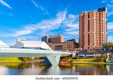 Adelaide, Australia - December 2, 2016: Adelaide city foot bridge leading to InterContinental hotel viewed through Torrens river on a bright day