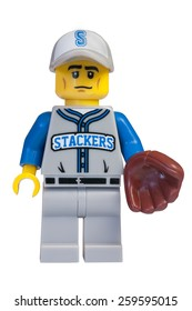 ADELAIDE, AUSTRALIA - February 06 2015:A studio shot of a Baseball Fielder Lego minifigure from Minifigure Series 10. Lego is extremely popular worldwide with children and collectors.