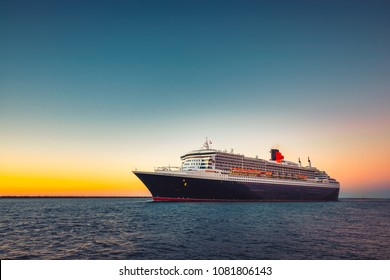 Adelaide, Australia - February 16, 2018: Cunard Line RMS Queen Mary 2 flagship with people on board leaving Outer Harbour in Port Adelaide for cruise to Melbourne