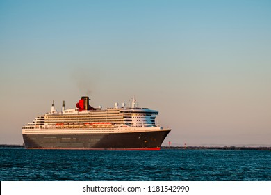 Adelaide, Australia - February 16, 2018: Cruise ship Queen Mary 2 with people on board departing from Outer Harbour in Port Adelaide