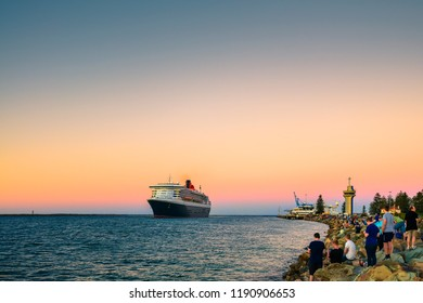 Adelaide, Australia - February 16, 2018: Cunard Line RMS Queen Mary 2 with people on board ready for departure for a cruise from Outer Harbour in Port Adelaide