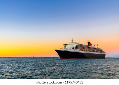 Adelaide, Australia - February 16, 2018: Cunard Line flagship Queen Mary 2 with people on board leaving Outer Harbour for cruise to Melbourne