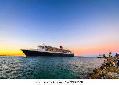 Adelaide, Australia - February 16, 2018:  Queen Mary 2 cruise ship leaving Outer Harbour passenger terminal
