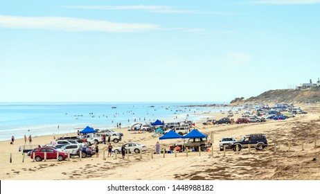 Adelaide, Australia - February 17, 2019: Aldinga drive on beach fully packed with people and cars on a hot summer weekend