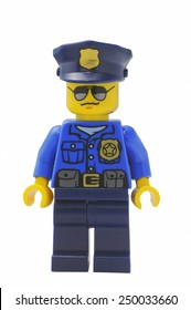 ADELAIDE, AUSTRALIA - January 09 2015:A studio shot of an Policeman Lego City minifigure from the popular Lego Series. Lego is extremely popular worldwide with children and collectors.