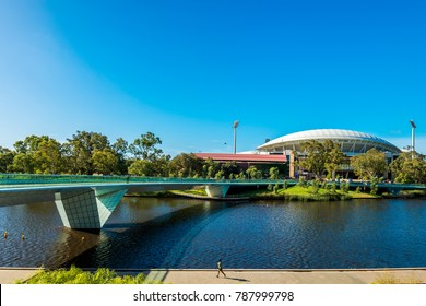 Adelaide, Australia - January 13, 2017: Iconic Adelaide Oval viewed across Torrens river foot bridge in Elder Park on a bright day
