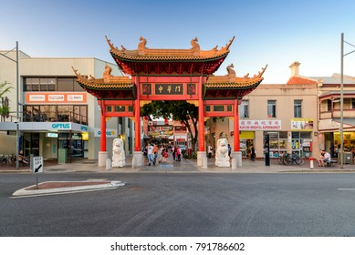 Adelaide, Australia - January 13, 2017: Chinatown with people in city centre of Adelaide viwed towards main entrance through Paifang on Gouger Street on a bright summer day