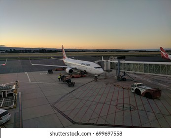 Adelaide, Australia - January 21 2017: Qantas 737 aircraft parked at gate at Adelaide Airport at sunrise.