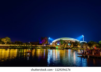 Adelaide, Australia - January 26, 2017: Lit up Adelaide Oval viewed across Riverbank during Australia Day celebration in Elder Park at night