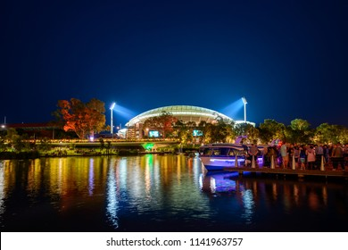 Adelaide, Australia - January 26, 2017: Lit up Adelaide Oval and Popeye boat viewed across Riverbank during Australia Day celebration in Elder Park at night