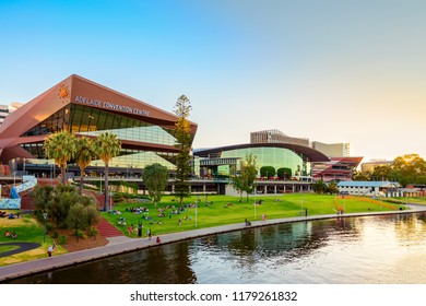 Adelaide, Australia - January 26, 2018: People relaxing on grass in front of Adelaide Convention Centre at Riverbank on Australia Day