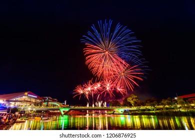 Adelaide, Australia - January 26, 2018: Australia Day fireworks on display in Elder Park viwed across Torrens river at night