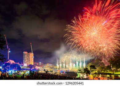 Adelaide, Australia - January 26, 2019: Australia Day celebration with fireworks on display in the city viewed across Torrens river at night