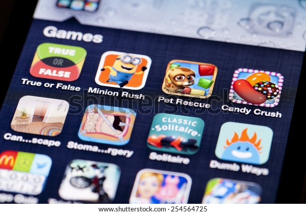 Adelaide, Australia - July 5, 2013: Close-up image of an iPhone screen with icons of game apps