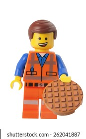ADELAIDE, AUSTRALIA - March 10 2015:A studio shot of a Emmet Lego minifigure from the Lego Movie. Lego is extremely popular worldwide with children and collectors.