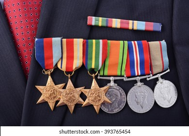 ADELAIDE, AUSTRALIA - MARCH 18, 2016: Original Australian Army WWII medals with the 1939 - 1945 Star, Africa Star, Pacific Star, Defence Medal, 1939 -1945 Medal and Australian Service Medal, closeup.