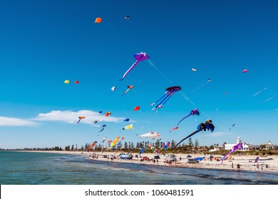 Adelaide, Australia - March 31, 2018: Adelaide International Kite Festival at Semaphore Beach viewed from jetty. Event gathered together kite flyers from Australia, New Zealand, USA and Japan