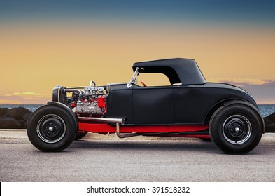 Adelaide, Australia - March 9, 2013: Custom Hot Rod parked near the beach at sunset
