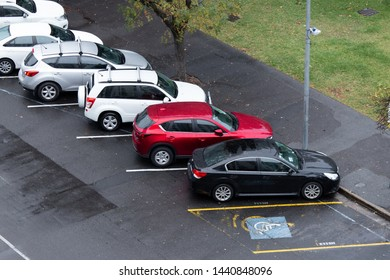 Adelaide, Australia - May 11, 2019: Top view of car parked in angled parking on the road side.