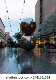 Adelaide, Australia - May 11, 2019: Low angle view of Malls Balls after rain with reflection.