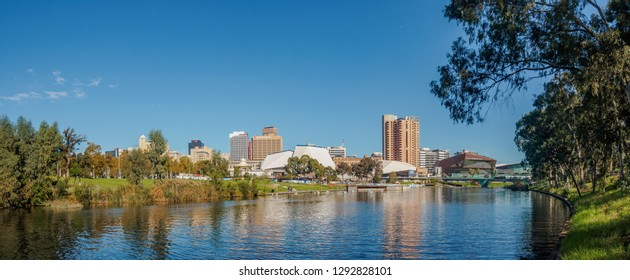 ADELAIDE, AUSTRALIA - MAY 5, 2017: Adelaide city centre viewed from the north side of Torrens river in Elder Park on a bright day